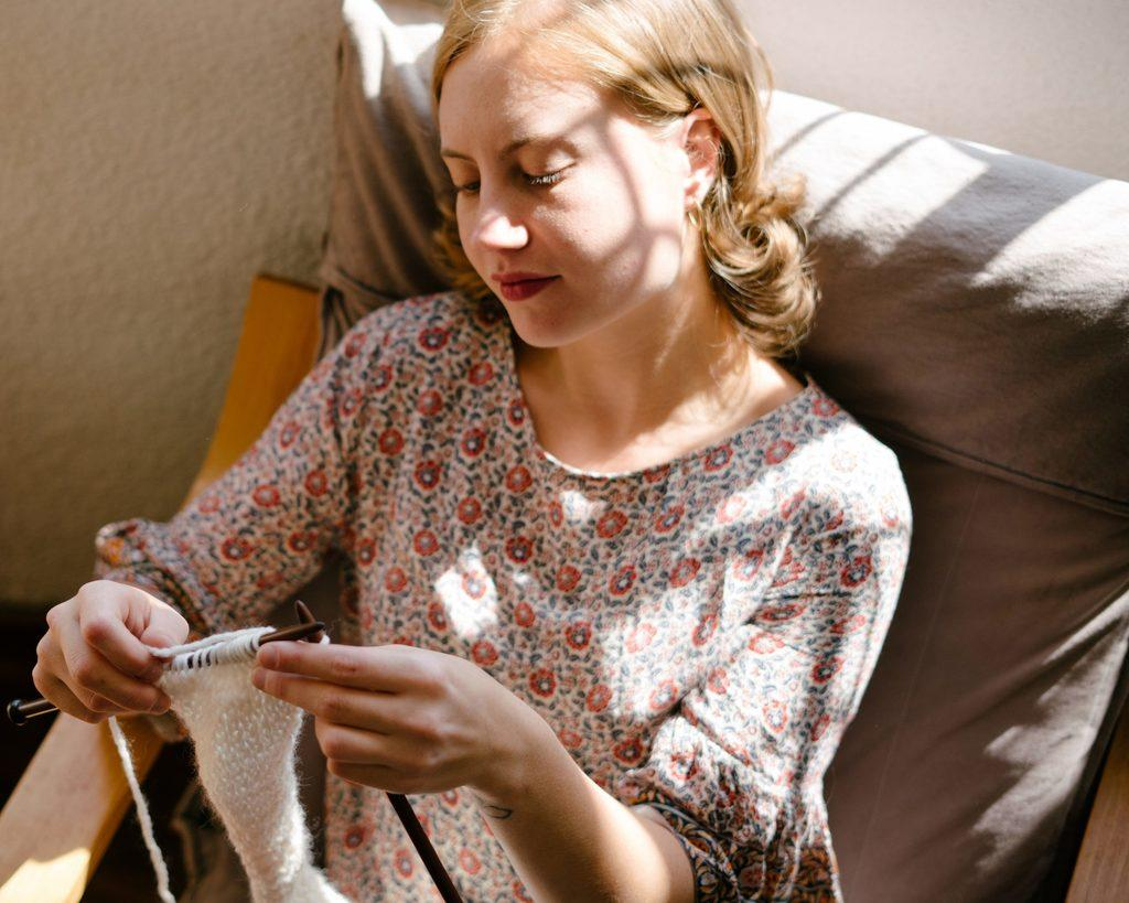 woman knitting to become self sufficient